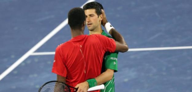 Gael Monfils con Novak Djokovic. Foto: Getty Images
