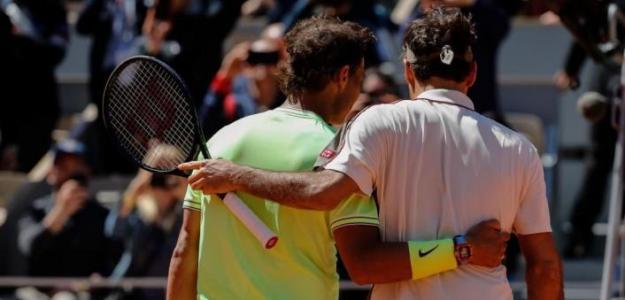 Federer y Nadal se saludan en la red. Foto: Getty