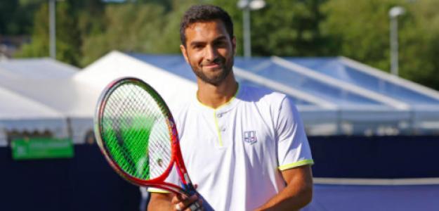 Noah Rubin blandiendo su raqueta. Fuente: Getty