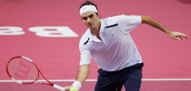 Roger Federer y la extinta moqueta. Foto: gettyimages