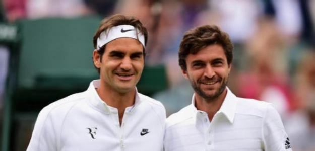 Roger Federer y Gilles Simon Foto: Getty